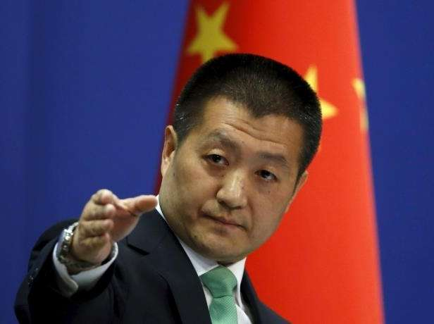 chinese-foreign-ministry-spokesman-lu-kang-points-out-a-reporter-to-receive-a-question-at-a-regular-_504076_.jpg